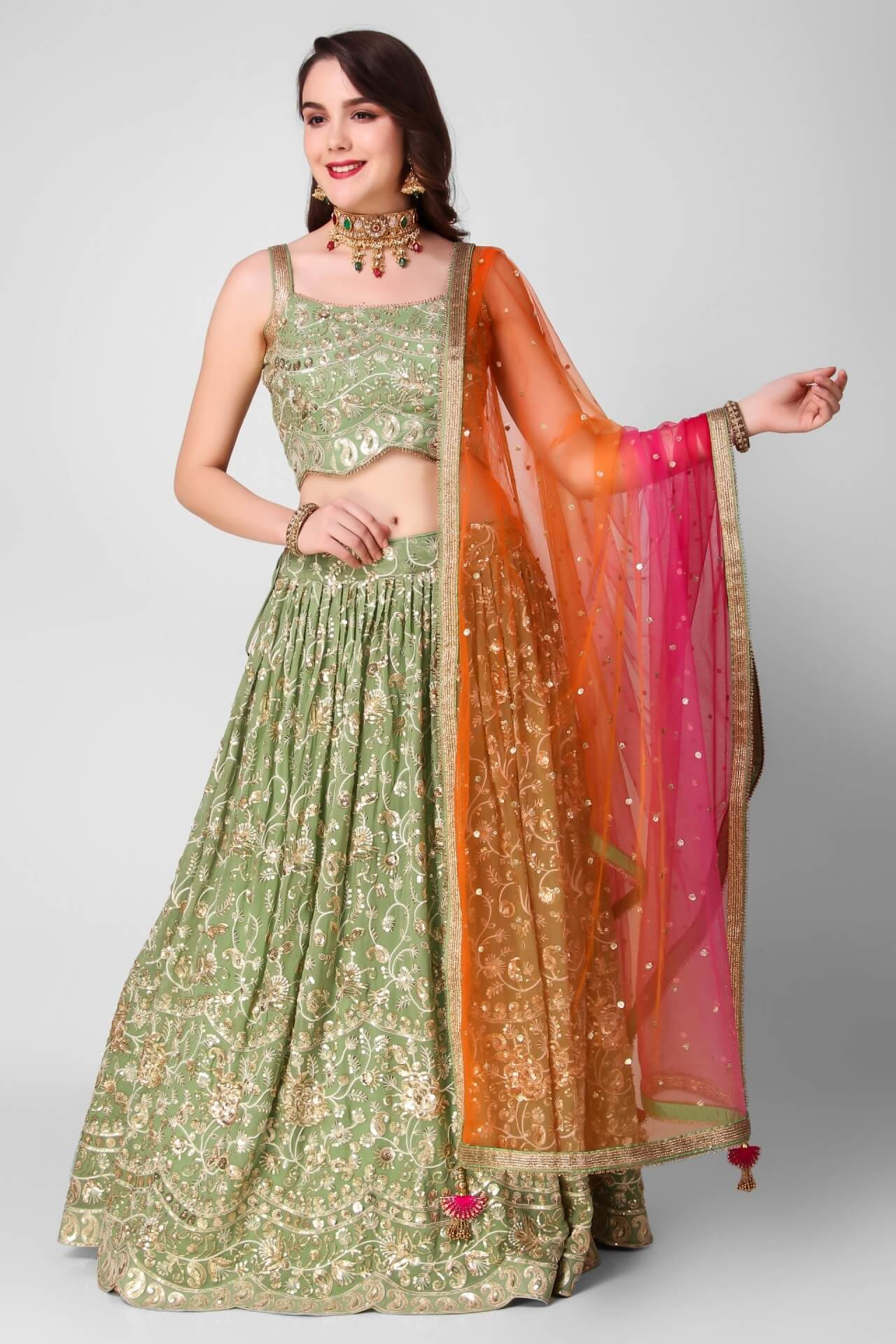 Heavy Embroidered Green Georgette Lehenga With Orange-Pink Dupatta